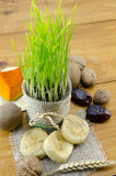 Young green wheat and dried fruit Stock Photo