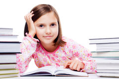 Young gril reading a book. Young student girl reading a book isolated on white background Stock Image