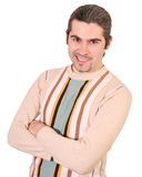 Young grinning handsome male in sweater isolated. Young smirking dark haired caucasian man in striped sweater with vicious expression on his face isolated Royalty Free Stock Image