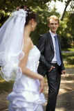 Young groom. Looking at his wife, holding his hand in his trouser pants stock photography