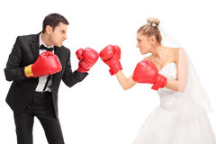 Young groom and a bride fighting each other Royalty Free Stock Photography
