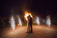Young groom and bride with two burning hearts fireshow Stock Photo