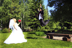 The young groom flies to meet his beloved bride. Stock Photography