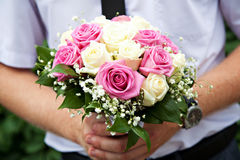 A young groom holding bouquet Royalty Free Stock Photography