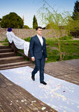 Young groom walking during wedding ceremony to bride Royalty Free Stock Images