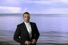 Young groom in wedding suit Royalty Free Stock Photography