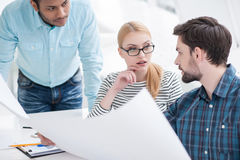 Young group of architects discussing business plans Stock Photos