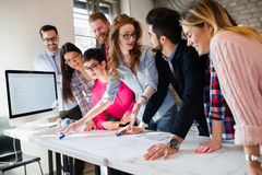 Young group of architects discussing business plans Stock Photo