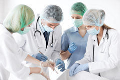 Young group of doctors doing operation Stock Image
