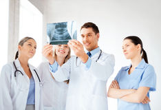 Young group of doctors looking at x-ray Stock Photography