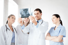 Young group of doctors looking at x-ray Stock Photos