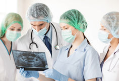 Young group of doctors looking at x-ray Royalty Free Stock Image