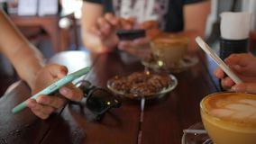 Young Group of Friends Talking and Using Mobile Smartphone Sitting in Cafe. stock video footage
