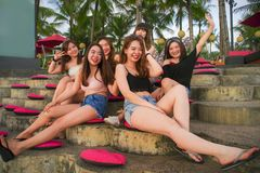 Young group of happy and beautiful Asian Chinese girls having holidays together hanging out enjoying at tropical resort in friends royalty free stock photography