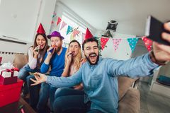 Young group of happy friends celebrating birthday. At home make selfie photo stock photos