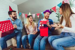Young group of happy friends celebrating birthday. At home and having fun royalty free stock images