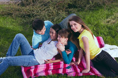 Young group laying in grass Stock Photo