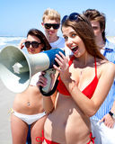 Young group with megaphone. At the beach during summer vacation Stock Photo