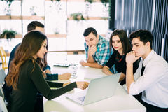 Young group of people discussing business plans. stock images