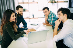 Young group of people discussing business plans. royalty free stock photography