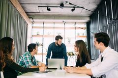 Young group of people discussing business plans. Stock Photography