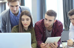 Young group of people doing their jobs on laptop. Royalty Free Stock Images