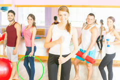 Young group people lead healthy lifestyle, exercise in fitness r Stock Photography