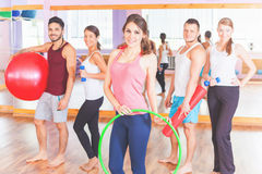 Young group people lead healthy lifestyle, exercise in fitness r Royalty Free Stock Photos