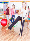 Young group people lead healthy lifestyle, exercise in fitness room Stock Photos