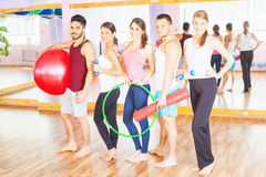 Young group people lead healthy lifestyle, exercise in fitness room Stock Images
