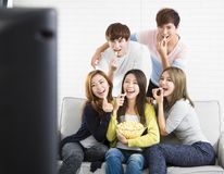 Young group Sitting On Sofa Watching TV. Show Royalty Free Stock Photo