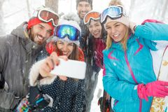 Group of skiers making photo. Young group of skiers making photo Royalty Free Stock Image