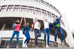 Young group of students jumping together Royalty Free Stock Images