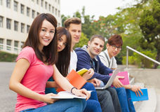 Young group of students sitting on the stair Royalty Free Stock Photos
