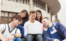 young group of students watching the laptop Stock Photos