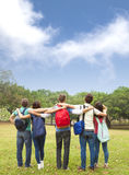 Young group of students watching the sky Stock Images
