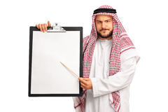 Young grumpy Arab holding a clipboard Stock Photo