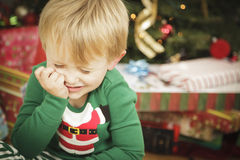 Young Grumpy Boy Sitting Near Christmas Tree Stock Photos