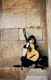 Young guitar performer Stock Images