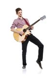 Young guitar player. Young handsome guitar player with his instrument. Studio shot on white background stock images