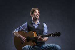 Young guitar player Stock Photography