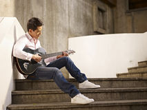 Young guitar player Stock Images