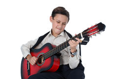 Young guitar player performing very passionately on a white back Royalty Free Stock Photo