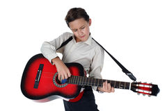 Young guitar player performing very passionately on a white back Stock Images