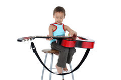Young guitar player 4 year old Royalty Free Stock Photos