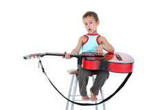 Young guitar player 4 year old on a white background Stock Image