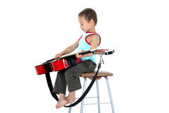 Young guitar player 4 year old on a white background Stock Photos