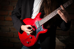 Young guitarist Stock Images