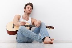 Young guitarist listening music eyes closed Stock Photo
