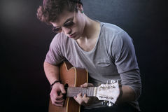 Young guitarist performing stock images